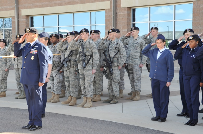 BUCKLEY AIR FORCE BASE, Colo. -- 460th Security Forces Squadron members salute during the National Police Week retreat ceremony May 10. (U.S. Air Force photo by Airman 1st Class Paul Labbe)