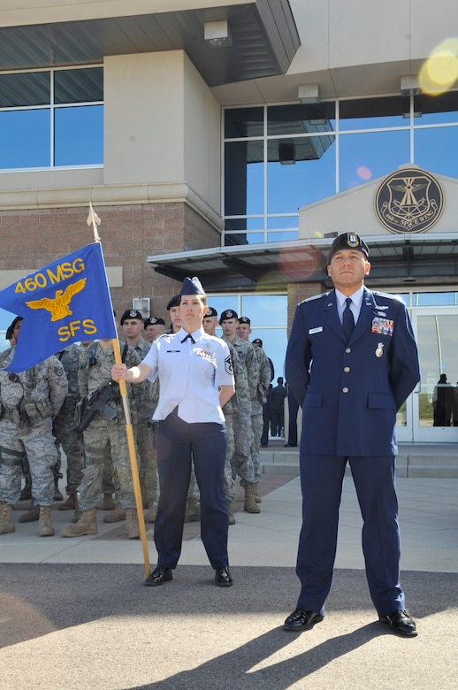 BUCKLEY AIR FORCE BASE, Colo. -- Capt. William Fejeran and Master Sgt. Deanna Snider, 460th Security Forces Squadron, stand at parade rest during the National Police Week retreat ceremony May 10. (U.S. Air Force photo by Airman 1st Class Paul Labbe)