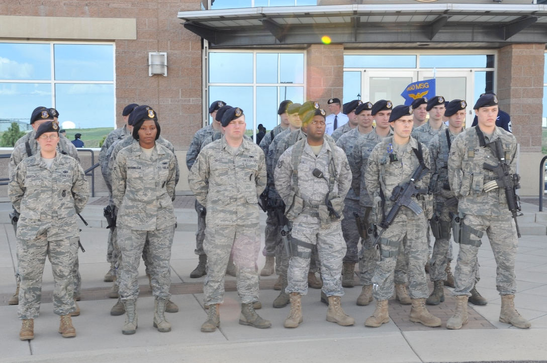 BUCKLEY AIR FORCE BASE, Colo. -- 460th Security Forces Squadron members stand at parade rest during the National Police Week retreat ceremony May 10. (U.S. Air Force photo by Airman 1st Class Paul Labbe)