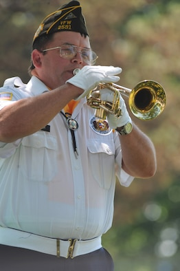 SEDALIA, Mo. - Mr. Daniel Aggeler, Veterans of Foreign Wars Post 2591 Honors Team bugler, plays taps at 2nd Lt. George Whiteman's memorial ceremony Saturday. The VFW Post 2591 Honors Team also retired the colors and performed a 21-gun salute at the ceremony. (U.S. Air Force photo/Airman 1st Class Carlin Leslie)