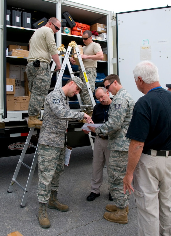– Members of the West Virginia Air National Guard's 167th Airlift Wing and Federal Emergency Management Agency held a joint inspection exercise at the air base here May 12 to ensure that if a disaster strikes anywhere in the world, equipment and supplies can be delivered expeditiously and safely. (U.S. Air Force photo by Emily Beightol-Deyerle)