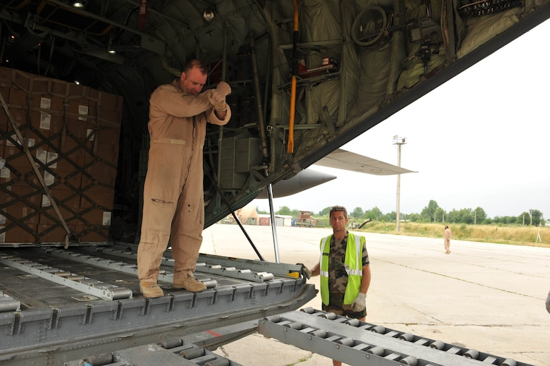 U.S. Air Force loadmaster Master Sgt. Mark Norman guides a forklift to the back of a C-130 Hercules to unload medical supplies, hygiene kits and water for flood victims at Dushanbe International Airport, Tajikistan, May 21, 2010.  Sergeant Norman is deployed to the 774th Expeditionary Airlift Squadron, Bagram Airfield, Afghanistan.   (U.S. Air Force photo/Staff Sgt. Quinton Russ/released)
