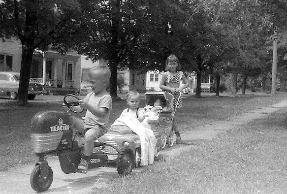 L-R:  Eric, Gary and Janis Crabtree playing in their Cassadaga, N.Y. neighborhood in the late 50s.  Maj. Gen. Eric Crabtree is now commander, Headquarters Fourth Air Force, March Air Reserve Base, Calif.  He began leading troops and giving orders at an early age, as depicted here.  (Courtesy photo)