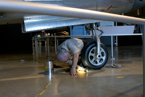 DAYTON, Ohio (05/2010) -- In preparation for the 60th anniversary of the Korean War, the National Museum of the U.S. Air Force is renovating its Korean War exhibit. Here, a restoration volunteer puts finishing touches on the F-84. (U.S. Air Force photo)