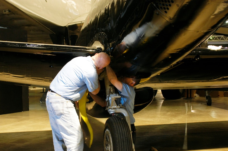 DAYTON, Ohio (05/2010) -- In preparation for the 60th anniversary of the Korean War, the National Museum of the U.S. Air Force is renovating its Korean War exhibit. Here, restoration specialists work on the F-82. (U.S. Air Force photo)