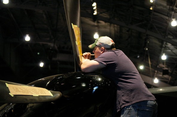 DAYTON, Ohio (05/2010) -- In preparation for the 60th anniversary of the Korean War, the National Museum of the U.S. Air Force is renovating its Korean War exhibit. Here, a restoration specialist paints stenciling on the F-82. (U.S. Air Force photo)