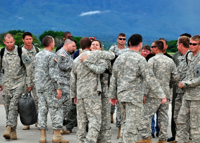 Joint Task Force-Bravo members greet Soldiers and Airmen from the 1st Battalion, 228th Aviation Regiment and JTF-Bravo who returned May 24 from supporting Joint Task Force-Haiti. The 1/228th along with other members of JTF-Bravo deployed in the middle of March from Soto Cano Air Base, Honduras to support JTF-Haiti, the U.S. military support unit for Operation Unified Response. (U.S. Air Force photo/Staff Sgt. Bryan Franks)