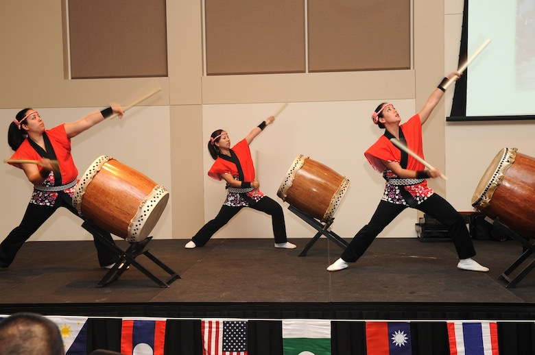 BUCKLEY AIR FORCE BASE, Colo. -- The Mirai Daiko all-female drumming group performs at the Asian Pacific Heritage food tasting May 26. The luncheon celebrated Asian-Americans' different cultures, history and traditions. (U.S. Air Force Photo by Airman 1st Class Manisha Vasquez)