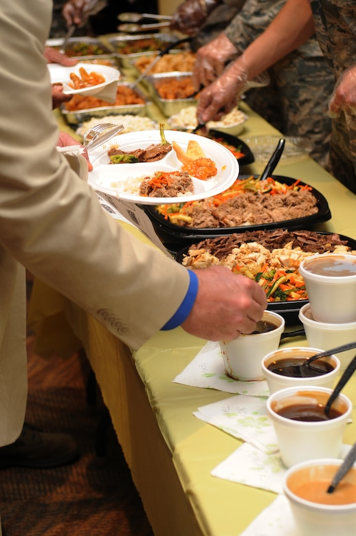 BUCKLEY AIR FORCE BASE, Colo. -- Members of Team Buckley sample cultural foods at the Asian Pacific Heritage food tasting May 26. (U.S. Air Force Photo by Airman 1st Class Manisha Vasquez)