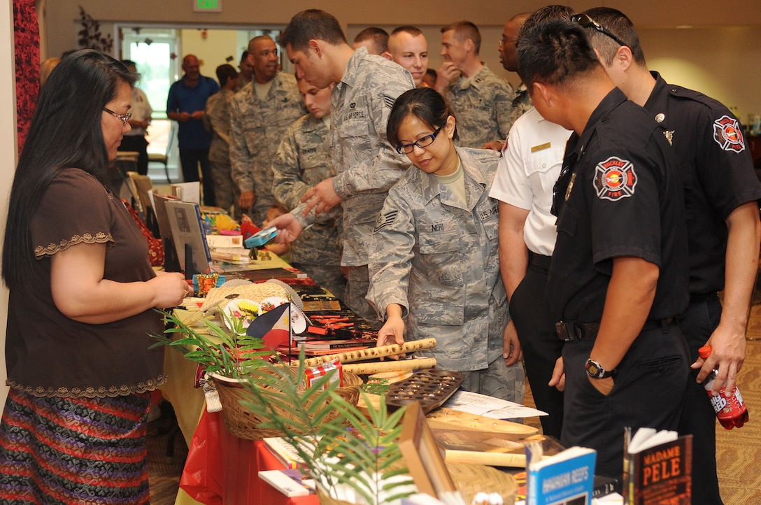 BUCKLEY AIR FORCE BASE, Colo. -- Members of Team Buckley examine cultural displays at the Asian Pacific Heritage food tasting May 26. The luncheon gave Team Buckley a taste of Asian-American heritage, culture and unique food. (U.S. Air Force Photo by Airman 1st Class Manisha Vasquez)
