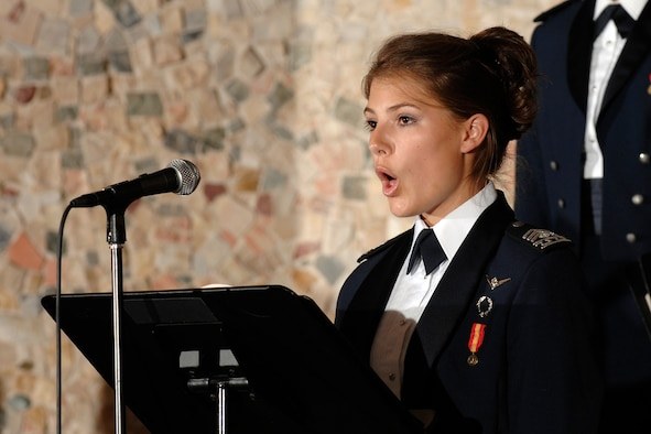 First soprano and then-Cadet 2nd Class Jill Larson takes center stage as soloist during the Cadet Chorale?s annual rendition of Handel?s ?Messiah? in December 2008. Cadet Larson, a native of Dodge City, Kan., graduated and received her commission May 26, 2010, and will attend intelligence officer school. (U.S. Air Force photo/Cadet 3rd Class Jami Larson)