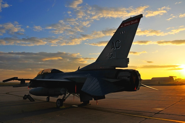 A U.S. Air Force F-16 Fighting Falcon aircraft assigned to the New Jersey Air National Guard's 177th Fighter Wing at Atlantic City International Airport sits on the flightline early in the morning May 20, 2010. Approximately 200 Airmen and 12 F-16s with the 119th Fighter Squadron from Atlantic City Air National Guard Base, New Jersey, are set to deploy in February to Osan Air Base, Republic of Korea, in support of the U.S. Pacific Command Theater Security Package. (U.S. Air Force photo/Staff Sgt. Matt Hecht)