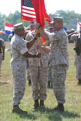 Col. Dan R. Masur Jr. (right) transfers the colors of Marine Special Operations Regiment to Col. Edward M. Jeffries Jr. during a change of command ceremony at the MARSOC headquarters building on May 27. The MSOR provides tailored military combat-skills training and advisor support for identified foreign forces in order to enhance their tactical capabilities and to prepare the environment as directed by USSOCOM as well as the capability to form the nucleus of a Joint Special Operations Task Force. Masur's next assignment will be as the MARSOC assistant chief of staff, G-3.