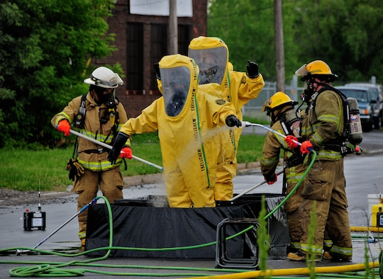 The Niagara Falls Air Reserve Station Fire Department lends support during a hazardous material spill at a chemical plant on Buffalo Ave., May 28, 2010, Niagara Falls, NY. The Niagara Falls Air Reserve Station Fire Department is one of the most current, qualified and trained for hazardous material calls in the Niagara Falls area. (U.S. Air Force photo by Staff Sgt. Joseph McKee)