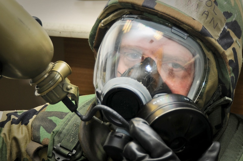 123rd Airlift Wing Chaplain (Lt. Col.) Fred Ehrman takes a drink from his canteen May 21, 2010 while under MOPP 4 conditions following a simulated chemical-weapons attack at the Gulfport Combat Readiness Training Center in Gulfport, Miss. The simulated attack was part of an Air Mobility Command Operational Readiness Inspection. (U.S. Air Force photo/Tech. Sgt. Dennis Flora)(Released)