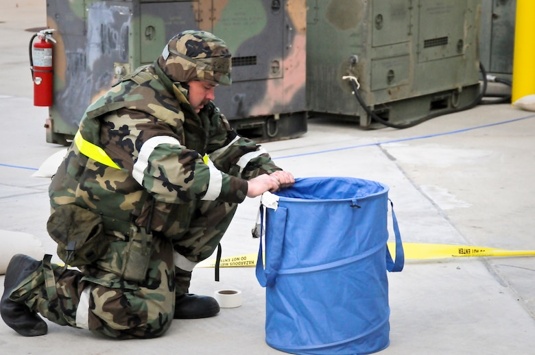 Tech. Sgt. Kelley Blair of the Kentucky Air Guard's 123rd Airlift Wing sets up a chemical warfare decontamination station May 21, 2010 at the Gulfport Combat Readiness Training Center in Gulfport, Miss. The 123rd and two other units were being evaluated by the Air Mobility Command Inspector General as part of an Operational Readiness Inspection. (U.S. Air Force photo/Tech. Sgt. Dennis Flora)(Released)