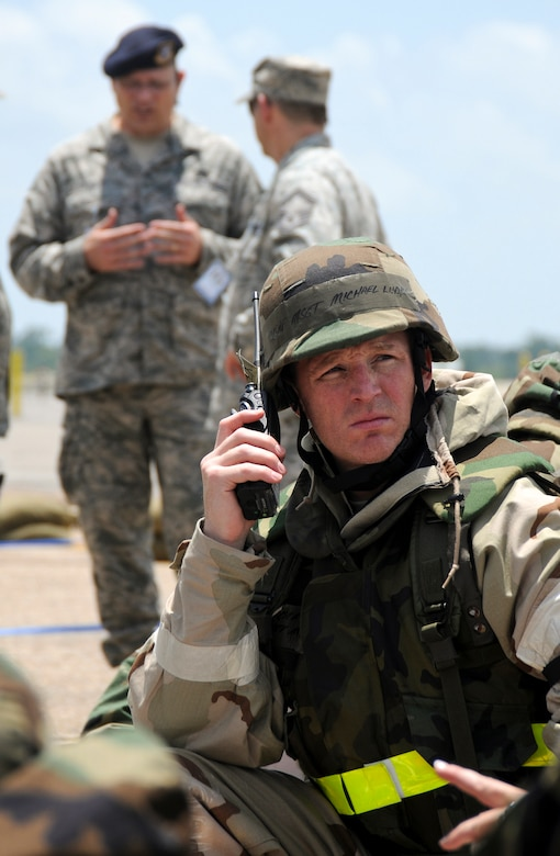 Master Sgt. Michael Ludke, an Nuclear-Biological-Chemical Warfare cell chief from the 123rd Airlift Wing, upchannels information during an evacuation of his building following a simulated attack May 20, 2010 at the Gulfport Combat Readiness Training Center in Gulfport, Miss. The 123rd and two other units were being evaluated for wartime readiness as part of an Air Mobility Command Operational Readiness Inspection. The ORI was unique in that it marked the first time inspectors evaluated a unit's performance in defense of the United States, using scenarios that played out on American soil rather than a simulated overseas environment. (U.S. Air Force photo/Tech. Sgt. Dennis Flora) (Released)