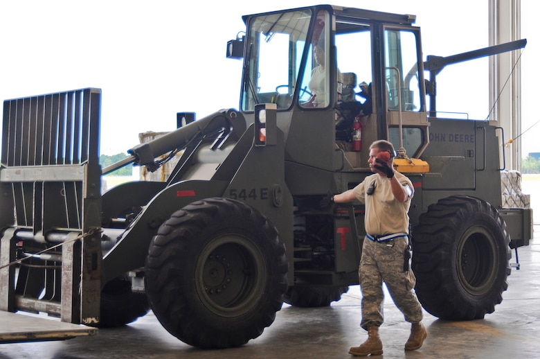 An Airman from the Air Force Reserve's 70th Aerial Port Squadron directs a forklift in the Main Hangar at the Gulfport Combat Readiness Training Center in Gulfport, Miss., on May 19, 2010. The cargo movement was part of an AMC Operational Readiness Inspection held in Gulfport from May 16-23. (U.S. Air Force photo/Tech. Sgt. Dennis Flora) (Released)
