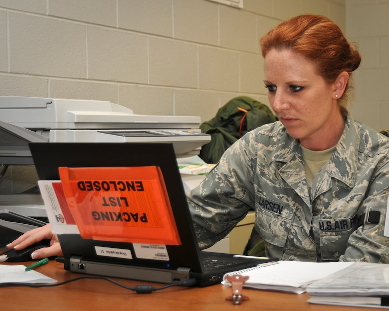 Master Sgt. Melanie Larsen, a paying agent from the Kentucky Air Guard's 123rd Airlift Wing Finance Office, reviews Air Force Instructions on May 19, 2010 at the Gulfport Combat Readiness Training Center in Gulfport, Miss. Sergeant Larsen was participating in an Air Mobility Command Operational Readiness Inspection. (U.S. Air Force photo/Tech. Sgt. Dennis Flora) (Released)