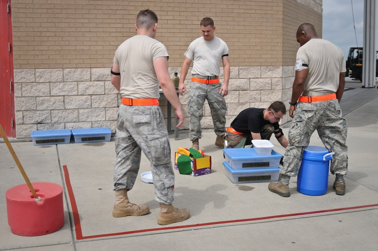 Airmen from the 317th Airlift Group at Dyess Air Force Base, Texas, set up a chemical decontamination station May 19, 2010, at the Gulfport Combat Readiness Training Center in Gulfport, Miss. The Airmen were participating in an Air Mobility Command Operational Readiness Inspection that also included more than 300 troops from the Kentucky Air Guard's 123rd Airlift Wing. The 123rd served as the lead unit for the inspection. (U.S. Air Force photo/Tech. Sgt. Dennis Flora) (Released)