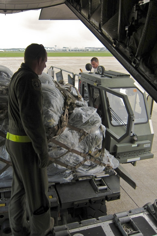 Loadmasters and ramp services personnel from the Kentucky Air Guard's 123rd Airlift Wing offload pallets of cargo from a C-130 onto a K-Loader at the Gulfport Combat Readiness Training Center in Gulfport, Miss., May 18, 2010. The wing was participating in an AMC Operational Readiness Inspection. (U.S. Air Force photo/Maj. Dale Greer)(Released)