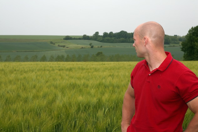 Capt. John Scheler, intelligence officer with Headquarters Company, 5th Marine Regiment and Marrysville, Penn. native,  looks out across the wheat fields at Hill 142 where in June 1918, the Marines of the 5th Regiment took heavy losses to German machine guns. The Marines of both the 5th and 6th Marine Regiments returned to Belleau Wood after 93 years to commemorate the battle their units fought in 93 years ago. During their trip, they conducted a walkthrough study of the attack and walked in the footsteps of their predecessors.