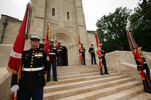 The colors sergeants from each battalion of the 5th and 6th Marine Regiments stand on the steps of the Aisne-Marne American Cemetery during a Memorial Day service in honor of the 93rd anniversary of the Battle for Belleau Wood. This year's ceremony marks the first time in 93 years that the Marines of the 5th and 6th Marine Regiments have returned to the battlefield together to honor their fallen comrades. More than 1,800 Marines from the 5th and 6th Regiments lost their lives in the 21-day battle that stopped the last German offensive in 1918.
