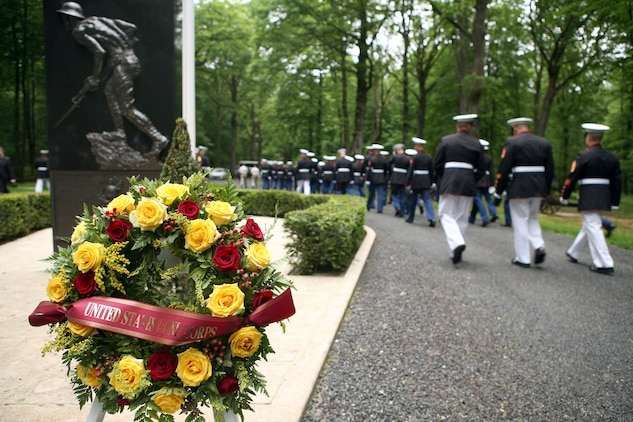 Marines depart the Iron Mike memorial area in the heart of Belleau Wood after a wreath laying ceremony in honor of the more than 1,800 Marines who died in the World War I Battle for Belleau Wood.