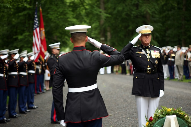 Commandant of the Marine Corps Gen. James T. Conway and Marines from Fleet Anti-Terrorism Security Team Rota, Spain salute at the Iron Mike memorial area in the heart of Belleau Wood during a wreath laying ceremony in honor of the more than 1,800 Marines who died in the World War I Battle for Belleau Wood.