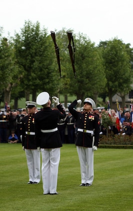 Members of the United States Marine Corps Silent Drill Team perform during a Memorial Day service in honor of the 93rd anniversary of the Battle for Belleau Wood at the Aisne-Marne American Cemetery. This year's ceremony marks the first time in 93 years that the Marines of the 5th and 6th Marine Regiments have returned to the battlefield together to honor their fallen comrades. More than 1,800 Marines from the 5th and 6th Regiments lost their lives in the 21-day battle that stopped the last German offensive in 1918.