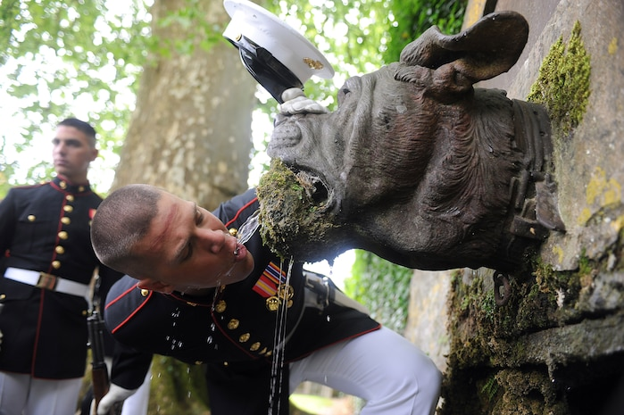 Lance Cpl. Seth H. Capps, a member of the United States Marine Corps Silent Drill Platoon, drinks out of Devil Dog Fountain following the 93rd anniversary of the Battle of Belleau Wood May 30. (Photo By Cpl. Bobby J. Yarbrough)