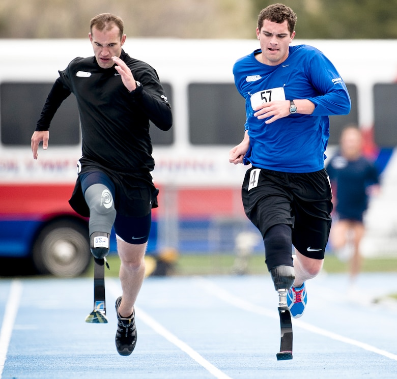 1st Lt. Ryan McGuire (right) sprints the last leg of the 1,500m dash to take fourth place during the Warrior Games May 14, 2010, in Colorado Springs, Colo. (U.S. Air Force photo/Tech. Sgt. Samuel Bendet)