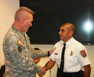 SOTO CANO AIR BASE, Honduras - Joint Task Force Bravo commander Col. Greg Reilly congratulated Mr. Herberth Gaekel on being named Air Combat Command Civilian Firefighter of the Year for 2010.  Mr. Gaekel is a civilian fire inspector for the 612th Air Base Squadron fire department here. (US Air Force photo/Capt. John T. Stamm)