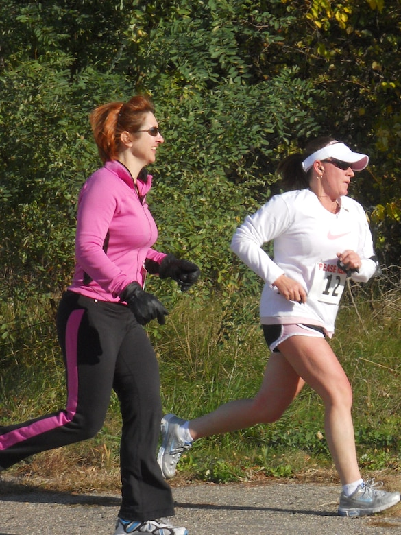 Capt. Darci Rubin (left) and Maj. Alyn Theriault of the 157th Medical Group take part in the 2nd Annual Pease Relay Race Oct. 17. (Photo: Chief Master Sgt. VInce Sherman)