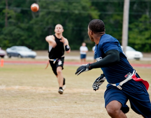Chase Whited, quarterback for the 96th Security Forces Squadron, throws to an open receiver during an intramural playoff game against the 53rd Wing Nov. 2 at Eglin Air Force Base, Fla.   The 53rd won the game 19-13 to advance in the tournament.  The championship game is Nov. 9 at 5 p.m.  (U.S. Air Force photo/Samuel King Jr.)