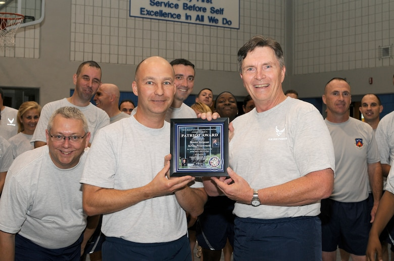 McGHEE TYSON AIR NATIONAL GUARD BASE, Tenn. - Colonel Richard B. Howard, right, commander of The I.G. Brown Air National Guard Training and Education Center, presents his Patriot Award to Master Sgt. Kevin J.Przewrocki, left, unit fitness coordinator, during the center's monthly fitness training session at Wilson Hall here, Oct. 27. The Patriot Award is Howard's personal award to show appreciation for those he feels have gone above and beyond in their service to the center.  (U.S. Air Force photo by Master Sgt. Kurt Skoglund/Released)