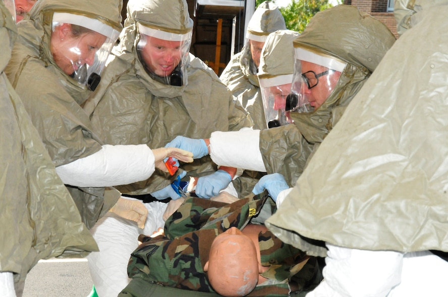 Members of the 134 ARW demonstrate how to remove clothing and decontaminate a patient.  The decontamination training was held to better prepare the Air National Guard members in case of a real world incident that may require decontamination of medically injured individuals.  The 134 ARW was the first Air National Guard base to recieve this specific training.  (US Air Force photo by Tech. Sgt. Kendra Owenby, 134 ARW Public Affairs/Released by Capt Gary Taft, 134 ARW PAO)