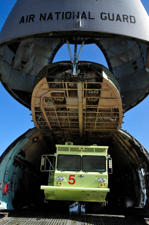 A P-15 Airport Rescue Firefighting Truck (ARFF) is loaded onto a C-5 Galaxy from New York Air National Guard for transport from the 134 ARW, McGhee Tyson Air National Guard Base, Tennessee to the 101st ARW, Bangor, Maine.  The truck has been in commission at MTAB since 1991 and is believed to be one of the last manufactured of its kind.  (US Air Force photo by Tech. Sgt. Kendra Owenby, 134 ARW Public Affairs/Released by Capt. Gary Taft, 134 ARW PAO)