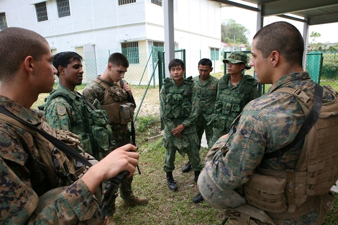 Republic of Singapore Army soldiers and Marines with Company A, Battalion Landing Team, 1st Battalion, 7th Marines, 31st Marine Expeditionary Unit, debrief their actions during Military Operations in Urban Terrain training, Nov. 6. Marines with the 31st MEU trained with soldiers from the Republic of Singapore Army to enhance their MOUT skills.