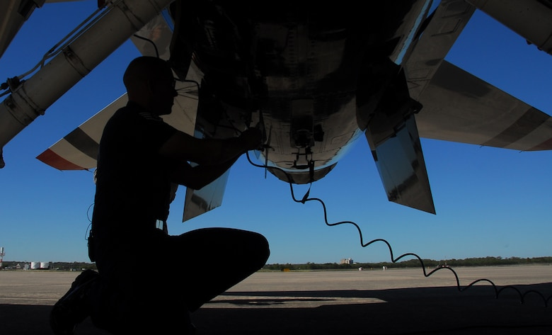 An Air Force Thunderbirds maintainer performs a pre-inspection on a Thunderbird F-16 Fighting Falcon prior to a flight Nov. 5, 2010, at Lackland Air Force Base, Texas. Unlike any other fighter squadron in the Air Force, the Thunderbird pilots do not do a typical walk-around inspection but rely on their crew chiefs to carry out that responsibility. The air demonstration team was at Lackland AFB to perform during AirFest 2010.  (U.S. Air Force photo/Staff Sgt. Jamie Powell)