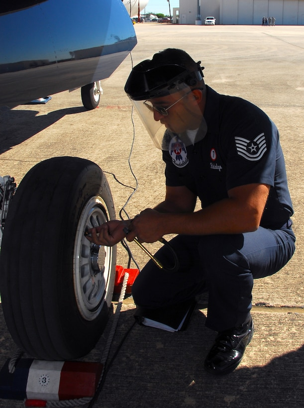 Tech. Sgt. Jose Hidalgo checks the tire pressure on an Air Force Thunderbird F-16 Fighting Falcon during his pre-inspection Nov. 5, 2010, at Lackland Air Force Base, Texas. Sergeant Hidalgo is a Thunderbirds assistant crew chief.  The air demonstration team was at Lackland AFB to perform during AirFest 2010.  (U.S. Air Force photo/Staff Sgt Jamie Powell)