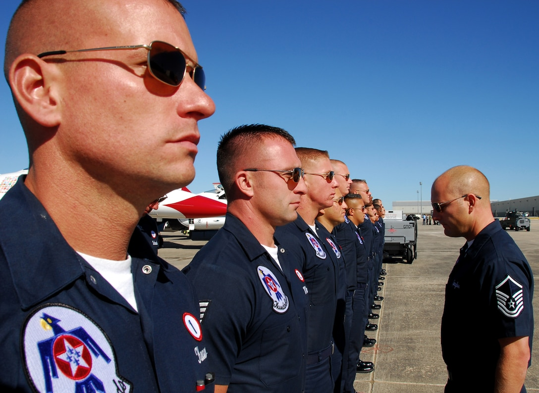 Before starting their aircraft pre-inspections Nov. 5, 2010, for an air show taking place Nov. 6 and 7 at Lackland Air Force Base, Texas, Air Force Thunderbird maintainers are inspected during open ranks. The Thunderbirds team is made up of 12 officers and more than 120 enlisted maintenance and support Airmen. (U.S. Air Force photo/Staff Sgt. Jamie Powell)