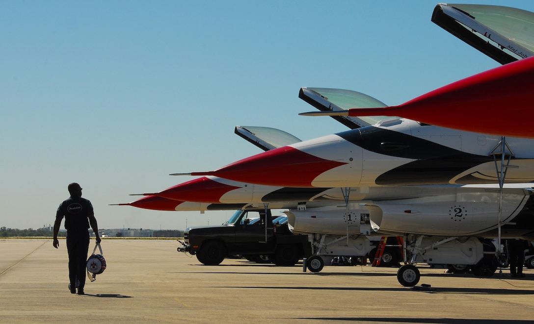 Air Force Thunderbird maintainers finish pre-inspections on the air demonstration team's F-16 Fighting Falcons Nov. 5, 2010, at Lackland Air Force Base, Texas. The Thunderbirds performed an air show Nov. 6 and 7 at Lackland AFB's AirFest 2010. (U.S. Air Force photo/Staff Sgt. Jamie Powell)