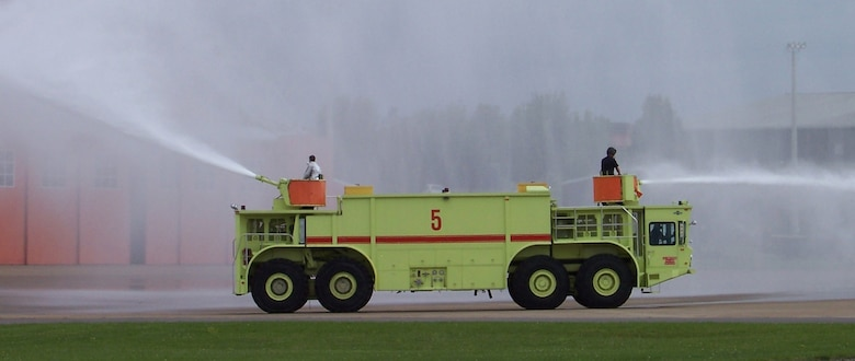 The Oshkosh P-15 Truck, Airport Rescue Fire Fighting (ARFF) is a 65 ton, 8x8 vehicle that was first fielded in 1977.  It carries 6,100 gallons of water and 515 gallons of foam, designed for all-weather operations at airfields for fire suppression.  Two 1,250 gpm pumps and two 1,200 gpm turrets deleiver the water and foam.  The Oshkosh P-15 ARFF is powereed by two Detroit Diesel engines.  The huge P-15 weighs 130,860 lbs, is 45 feet long, 10 ft wide and 13.8 feet tall.  (Air Force photo by Chief Master Sgt. Robert McCormack, 134 ARW Fire Dept.)