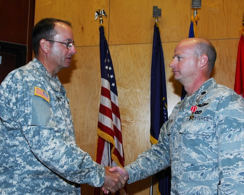 Lt. Col. Nathan Nelson, 151st Civil Engineering Squadron, Utah Air National Guard, receives a Bronze Star medal from Maj. Gen. Brian Tarbet, the Utah National Guard Adjutant General, at a ceremony on November 7. Colonel Nelson received the award for his distinguished service as the Facility Engineering Team Officer-in-Charge in Iraq from November 2009 through May 2010.(U.S. Air Force photo by Tech. Sgt.  Kelly Collett)(RELEASED)