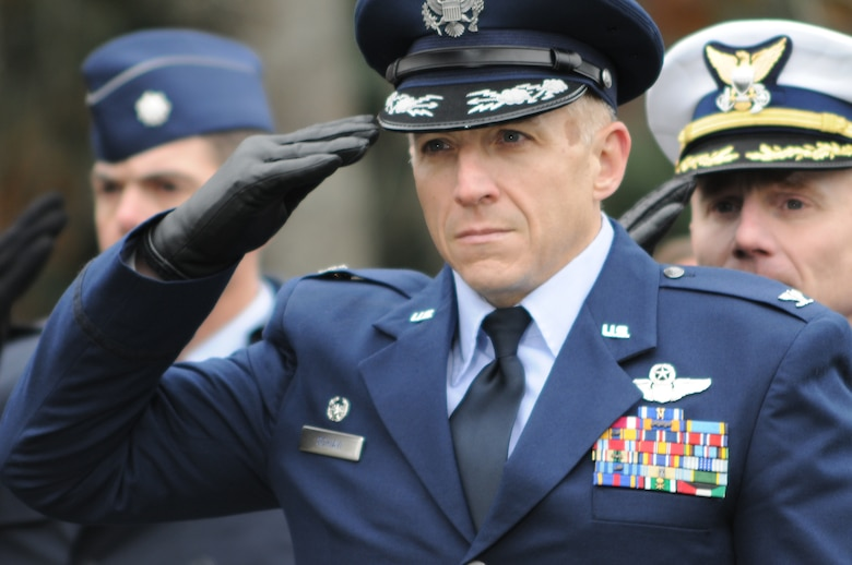 On November 7, 2010, a Veterans Day ceremony was held at the Massachusetts National Cemetery in Bourne, Mass. In this photo, Colonel Anthony E. Schiavi, Commander of the 102nd Intelligence Wing, salutes while TAPS is being played.