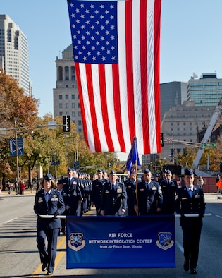 ST LOUIS, Mo. -- Airmen from the Air Force Network Integration Center at Scott Air Force Base, Ill., march in formation down Market Street in downtown St. Louis as part  of the city's 27th annual Veterans Day parade Nov. 6.  (U.S. Air Force photo/MSgt G. Shawn Lowry)