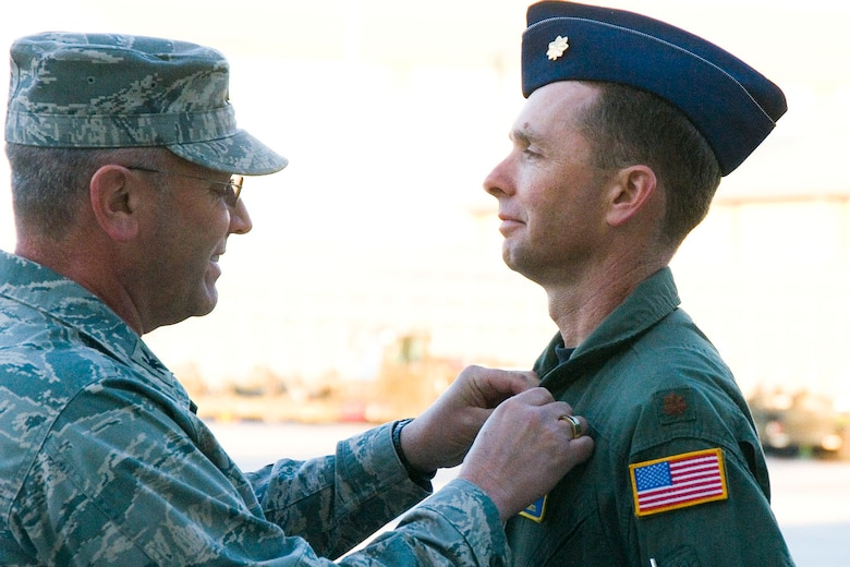 Col Roger Nye, 167th Airlift Wing commander, pins a Bronze Star Medal on Major Peter Gross during a commanders call at the unit on October 3, 2010. Gross was awarded the Bronze Star for his yearlong deployment as a senior command and control advisor to the Afghan National Army Air Corps. (U.S. Air Force photo by MSgt Emily Beightol-Deyerle)