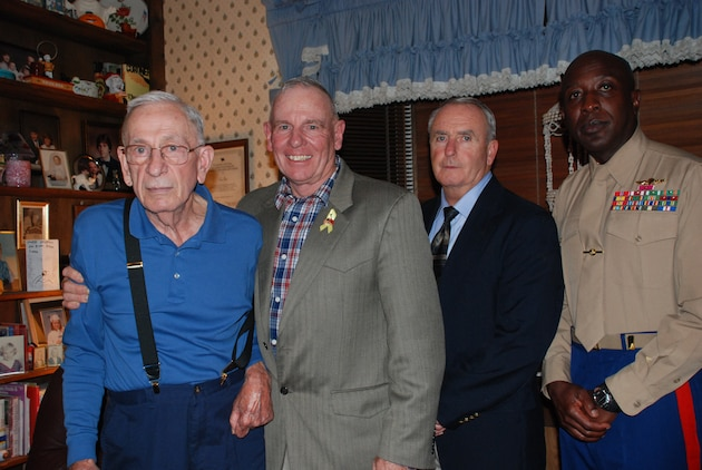 Former Sgts. Maj. of the Marine Corps Henry H. Black, 7th SMMC; Harold G. Overstreet, 12th SMMC; Gary Lee, 13th SMMC; and the current SMMC, Carlton W. Kent, the 16th.  Overstreet, Lee and Kent made a trip to Black's home, with about 15 other Marines and family members, in Fredericksburg, Va., to ensure Black had a Marine Corps birthday celebration on Nov. 10, 2010.