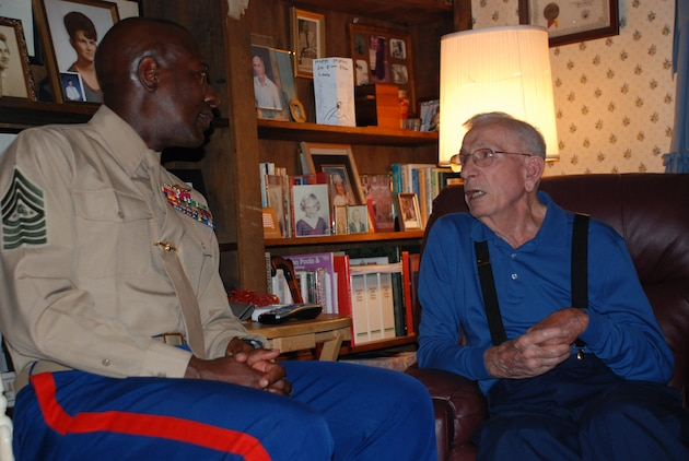 Sergeant Maj. Carlton W. Kent, the 16th Sergeant Major of the Marine Corps, talks with retired Sgt. Maj. Henry H. Black, the 7th SMMC, in Black's home in Fredericksburg, Va., on the Corps' 235th Birthday Nov. 10, 2010.  Kent, along with approximately 15 fellow Marines and family members, made the trip to Black's for the second consecutive year to ensure he had a proper Marine Corps birthday celebration.